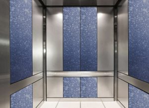 antique mirror in an elevator with blue grey decorative glass pattern