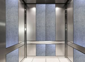 antique mirror in an elevator with bright white decorative glass pattern