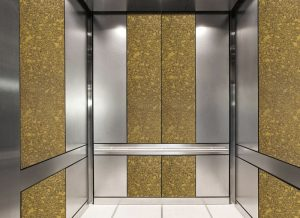 antique mirror in an elevator with gold bronze decorative glass pattern