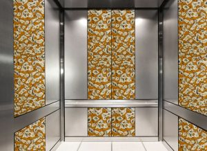 antique mirror in an elevator with copper swirl decorative glass pattern