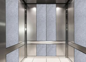 antique mirror in an elevator with dark white decorative glass pattern