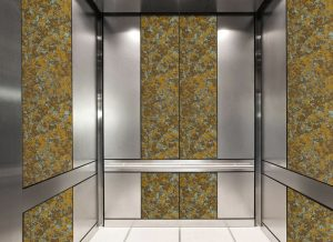 antique mirror in an elevator with dense copper decorative glass pattern
