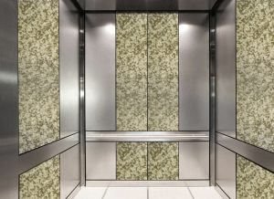 antique mirror in an elevator with green white decorative glass pattern