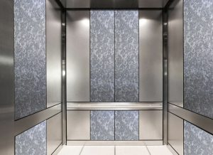 antique mirror in an elevator with grey swirl decorative glass pattern