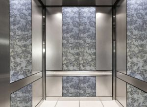 antique mirror in an elevator with intense white decorative glass pattern?