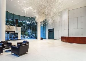White Decorlite back painted glass walls at the Midtown Plaza Lobby in Atlanta
