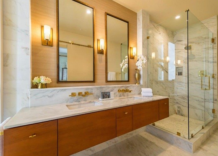 Dewberry Hotel Bathroom with Fiji Glass Shower Enclosure with Brass Hardware