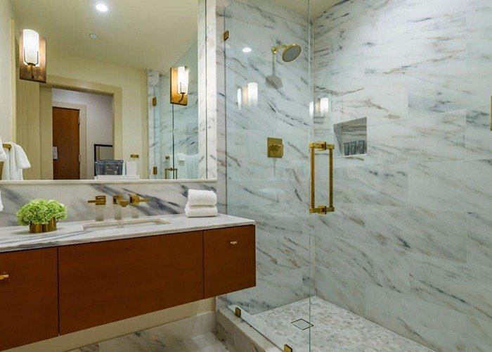 Dewberry Hotel Fiji Glass Shower Doors with Brass Hardware