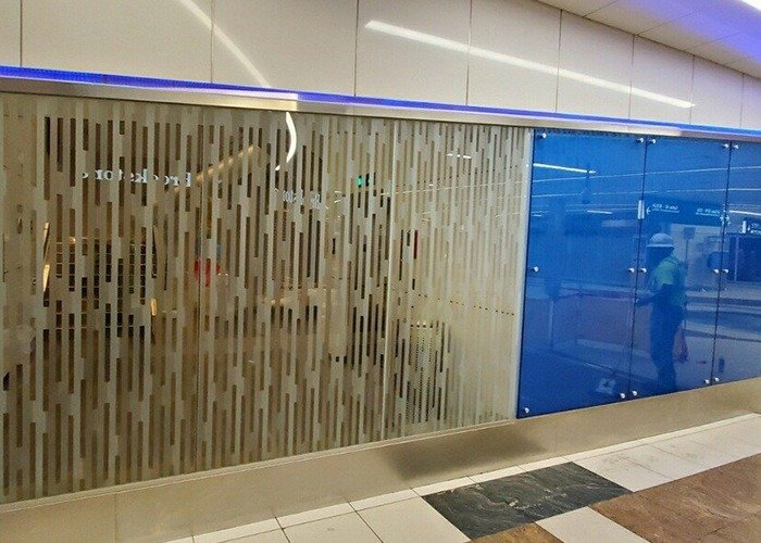 Delta Sky Club Laminated and etched glass walls and partitions