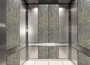 antique mirror in an elevator with white cloud decorative glass pattern