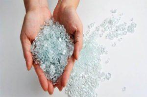 broken tempered glass in womans hands