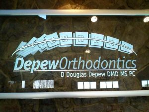 Frosted, carved, and LED edge lit glass sign for Depew Orthodontics