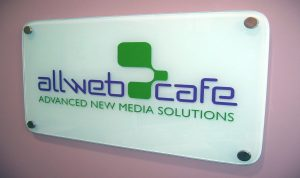 Carved, in-filled, and back painted glass sign for Allweb Cafe