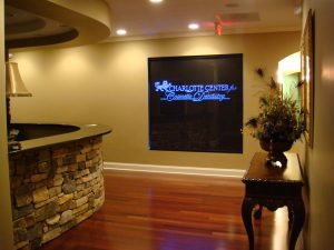 Carved and LED edge lit glass sign for Charlotte Center for Cosmetic Dentistry