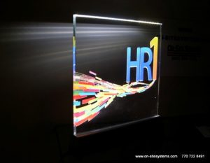 HR1 carved, in-filled, and LED edge lit glass sign