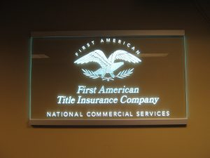 Carved and LED edge lit glass sign for First America Insurance
