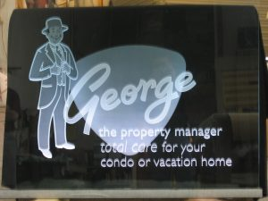 Carved and etched LED lit glass sign for George Property Manager