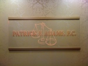 Carved and LED lit glass sign for Patrick Adams P.C.