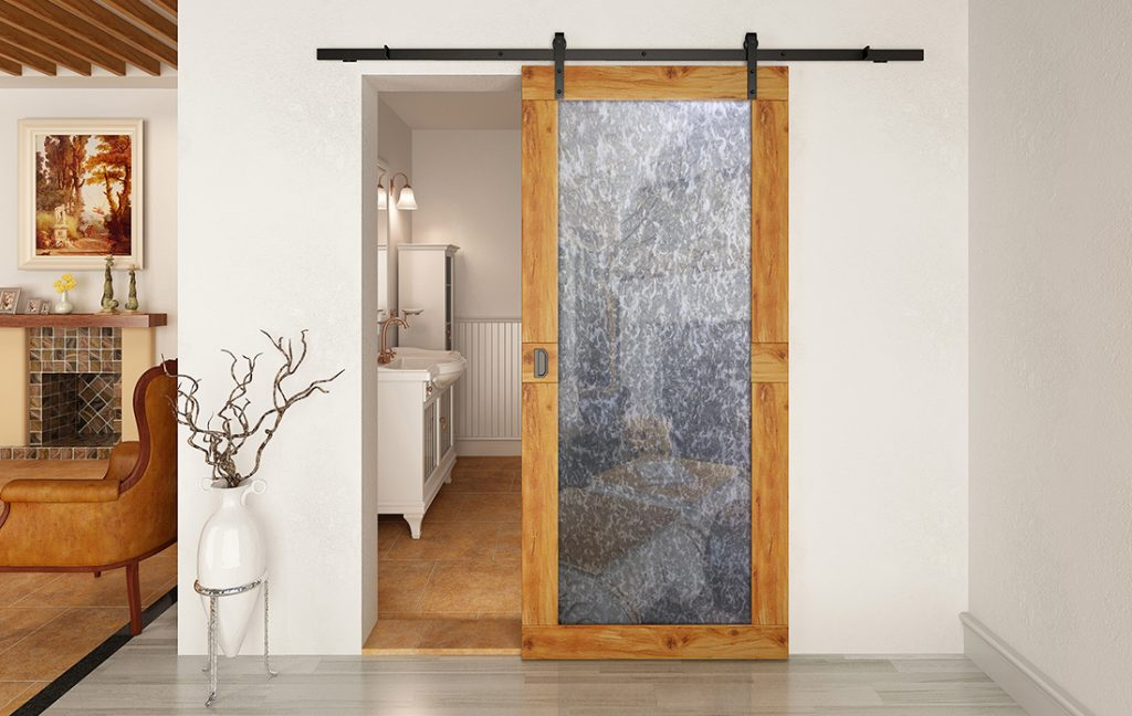Barn door with inset antique mirrror